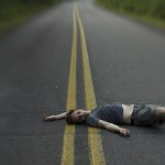 guy lying in the road
