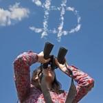 Woman watching with binoculars